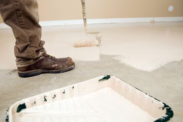 Painter painting garage floor in Topsfield